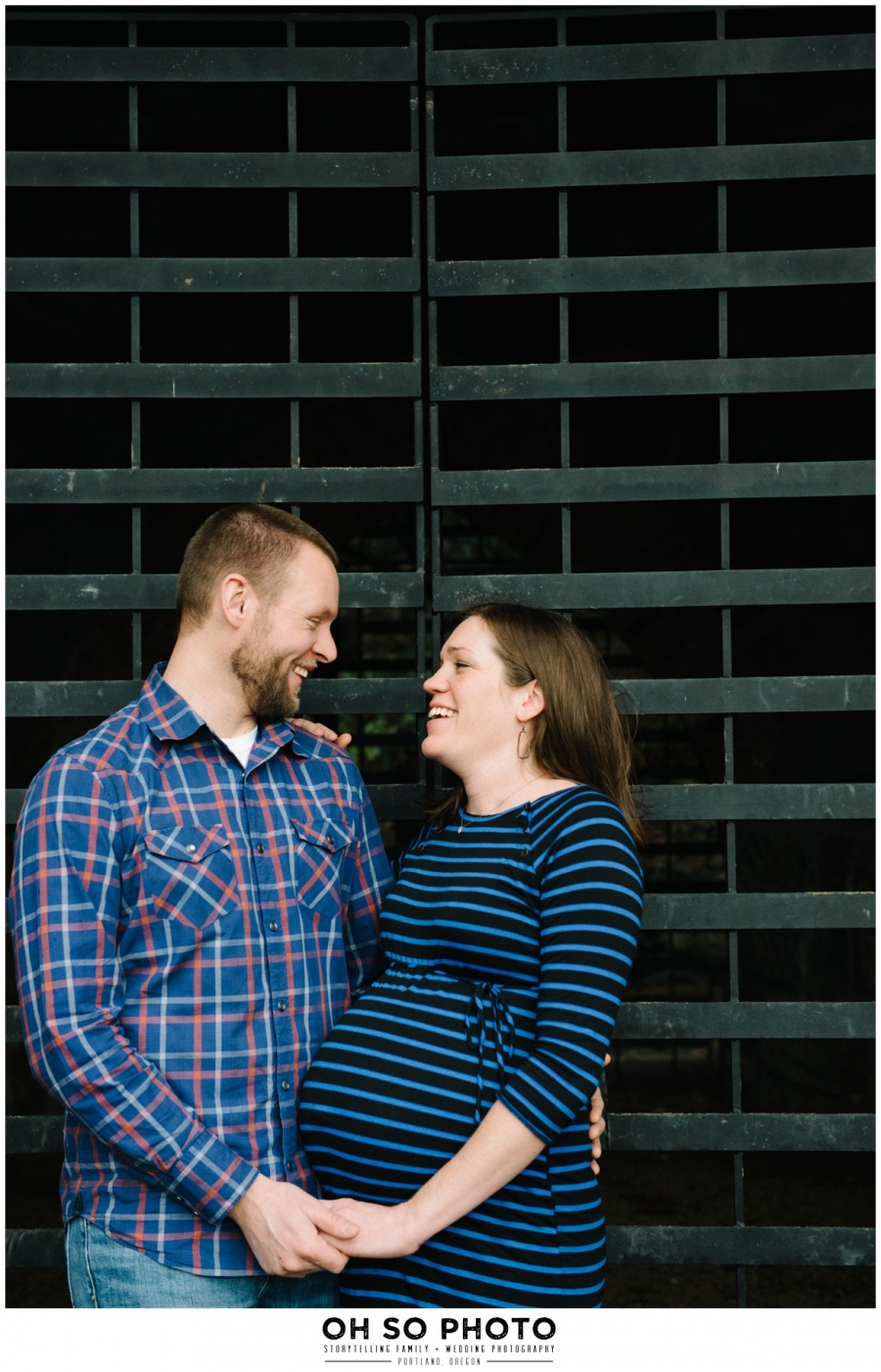 married couple with pregnant mom stripes and plaid