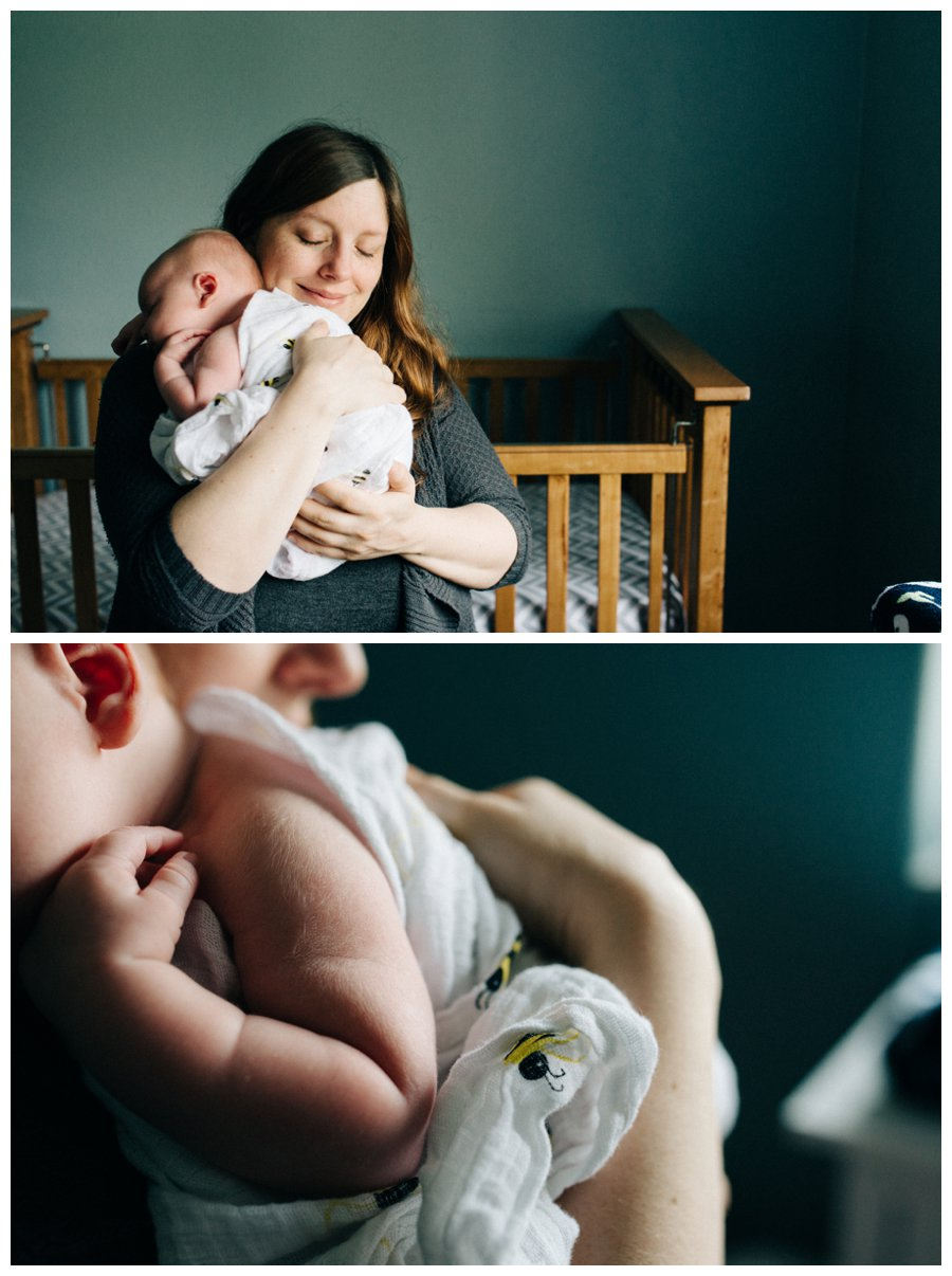 mother holding newborn boy with her eyes closed